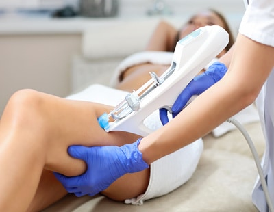 Picture of woman having leg mesotherapy in beauty salon